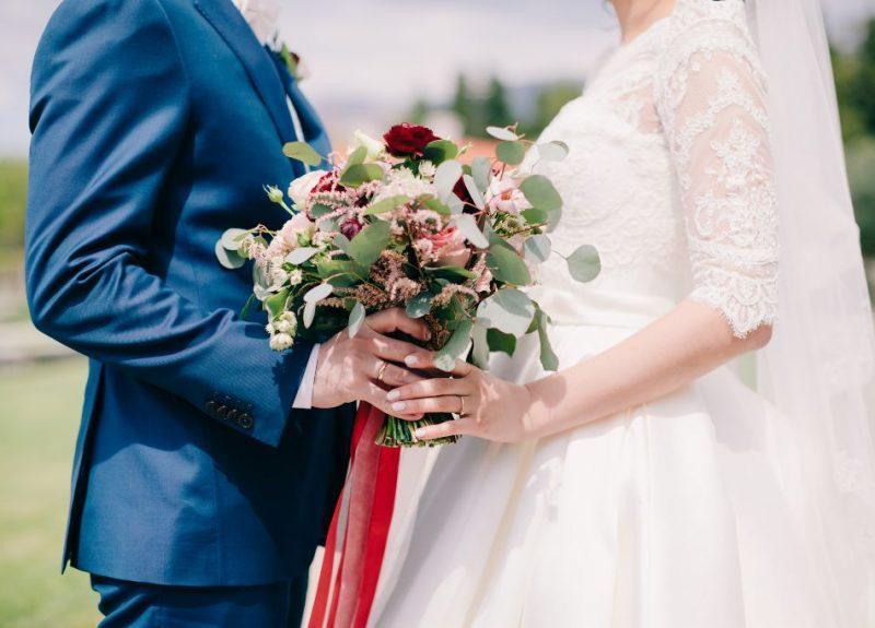 bride-and-groom-holding-wedding-bouquet-2021-09-01-01-57-18-utc (1)